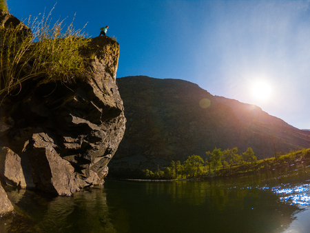 Steep cliff on the river of Chulyshman, Altai, Russia