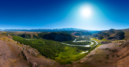 Panorama of the snow caped Northen Chuysky Range and green valley of the river of Chuya. Altai Republic, Russia
