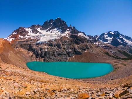 Cerro Castillo mountain and lake with turquoise water near it. Chile