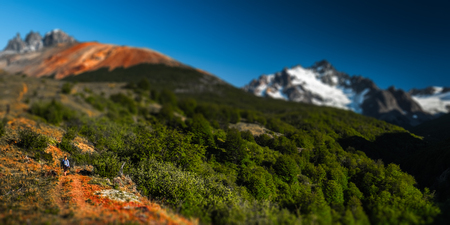 Hiker walks in mountains. Chile Patagonia. Tilt shift effect applied Stock fotó