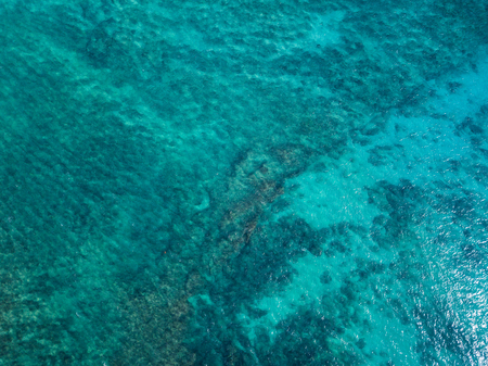 view of the tropical sea surface with coral reefs on the bottom Banco de Imagens