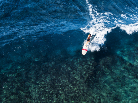 view of the surfer riding the perfect crystal clear wave of Oahu island, Hawaii