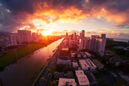 City of Honolulu during colorful sunrise. Hawaii, USA Stock Photo
