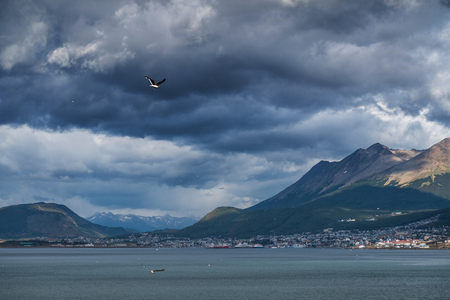 City of Ushuaia and dark stormy sky. Argentina