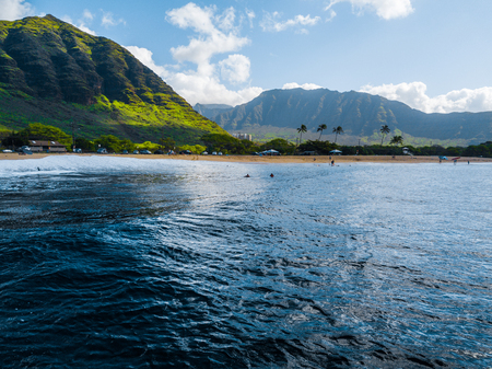 view of Makaha beach with the green mountains on the background. Oahu, Hawaii Stock Photo