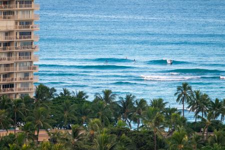 People surf on Waikiki beach Oahu, Hawaii, USA Stock Photo