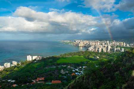 Rainbow and rainy clouds over the city of Honolulu, Oahu, Hawaii