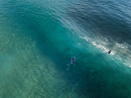 Aerial view of the surfers in the ocean. Oahu, Hawaii