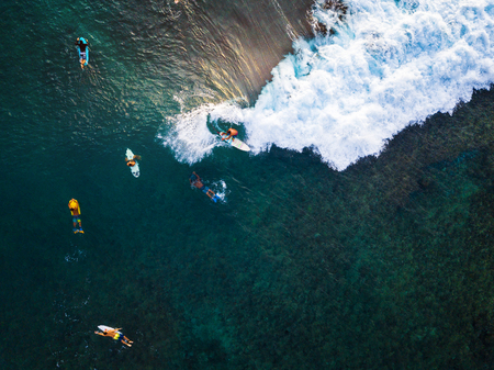 Aerial view of the surfers having fun on small waves. Oahu, Hawaii Stok Fotoğraf - 117463314
