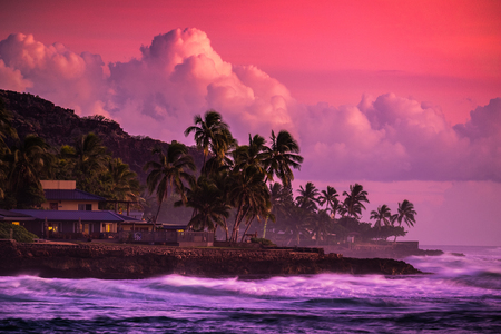 Bright purple sunset at West Coast of Oahu, Hawaii Stock Photo