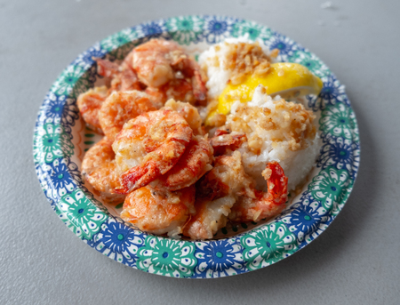 Garlic shrimps served with white rice and lemon slice - famous dish of the North Shore of Oahu, Hawaii Stock Photo