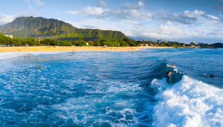 Panorama of the surf spot Makaha with the surfer riding the wave. Oahu, Hawaii Stock Photo
