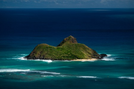 Moku Nui island surrounded by the Pacific Ocean. Oahu, Hawaii
