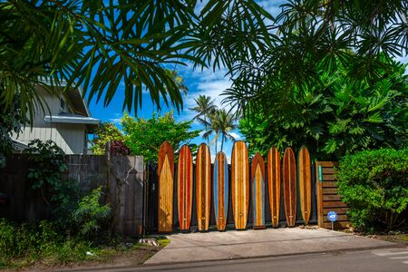 OAHU  USA - 09 JANUARY 2019: Fence of the property made of the decorative colorful surf boards, located near the famous Pipeline surf spot on the North Shore of Oahu