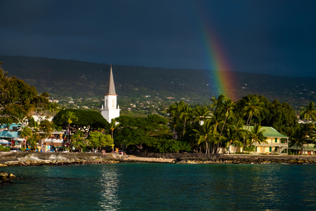 White church and rainbow over the city of Kailua Kona, Big Island, Hawaii