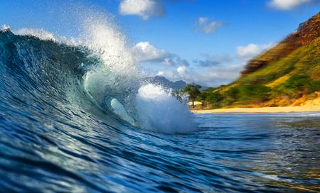 Powerful crystal clear ocean wave breaks on shore. West Coast of Oahu, Hawaii Stock Photo