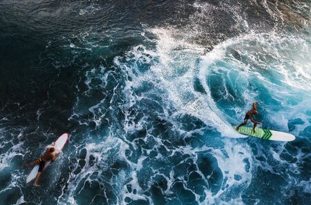 OAHU  USA - 17 NOVEMBER 2018: Aerial view of the surfers in the ocean. Oahu, Hawaii