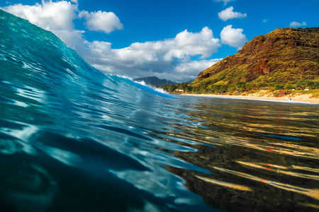 Smooth and glassy wave ready to break on shore. Oahu, Hawaii
