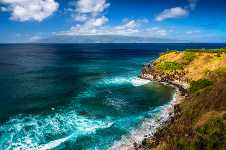 Honolua Bay with waves and surfers in the water. Maui, Hawaii