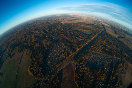 Aerial view of the suburban area of the city of Izhevsk (visible on the horizon) at autumn. Russia Фото со стока