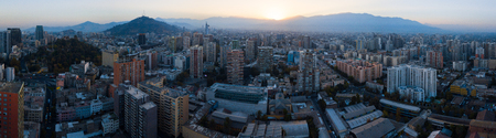 Aerial panorama of the city of Santiago de Chile during sunrise. Chile.