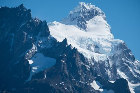Close view of the snow capped mountains of Cordillera Paine in Torres del Paine National Park in Chile Stock fotó