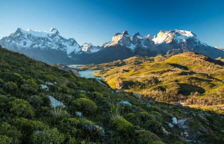 Torres del Paine National Park during sunset. Chile. Focus on the grass on the foreground Stock fotó