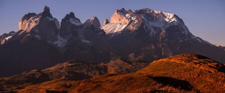 Panoramic shot of the snow and ice capped mountains - Cordillera Paine in Torres del Paine National Park in Chilean Patagonia during sunset