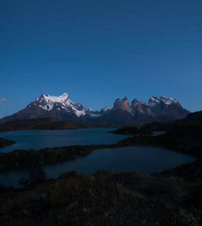Torres del Paine National Park during the twilight before sunrise with some bright stars in the sky. Chile Stock fotó