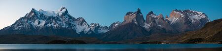 Panorama of Torres del Paine National Park with snow capped mountains (Cordillera Paine) and calm lake of Pehoe at late evening with stars in the sky. Chile Stock fotó