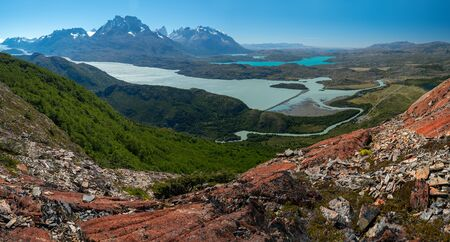 Panorama of the Torres del Paine National Park with rivers, blue lakes, coniferous green forests and snow capped mountains of Cordillera Paine. Chilean Patagonia Stock fotó