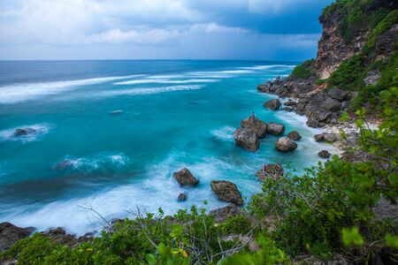 Ocean with waves and rocky coast. Bali, Indonesia
