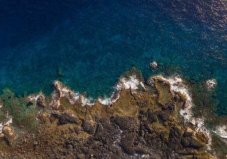 Aerial top down view of the coastline of the Big Island, Hawaii