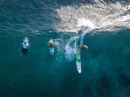 OAHU, HI / USA - NOVEMBER 15, 2018: Aerial top to down view of the Makaha surf spot located on the lee shore of Oahu with lots of surfers in the water Editorial