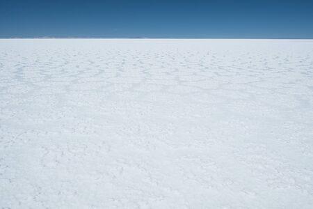Flat and white surface of the Salar de Uyuni, Bolivia Stock Photo
