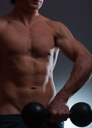 Man with naturally looking body (hairs and birthmarks) holds dumbbell