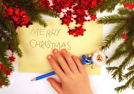Christmas greetings written by small boy photo