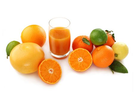 Still life with citruses and juice