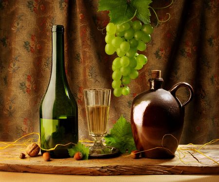 Still life with wine and hanging grape