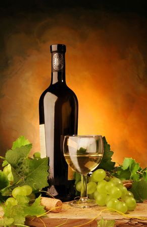 green glass bottle: Still life with white wine and grapes Stock Photo