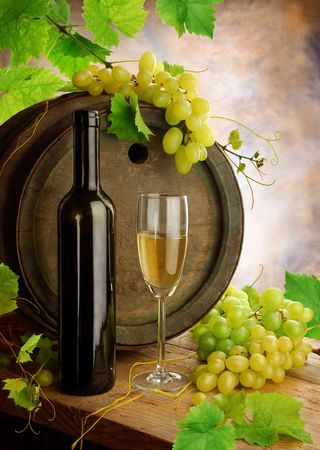 still life of wine: White wine still life with old barrel Stock Photo