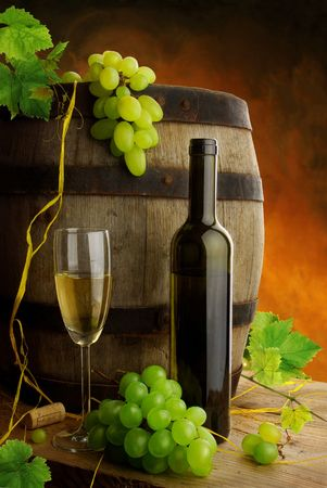 vine leaves: White wine and old barrel still life Stock Photo