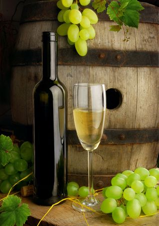 Detail of barrel and wine still life with grapes photo