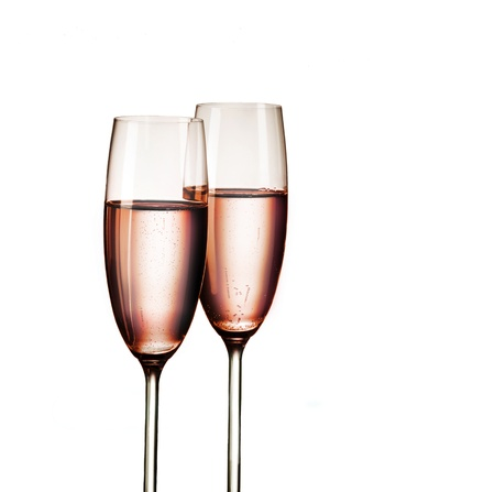 champagne flute: Two glasses of pink champagne, isolated on white background