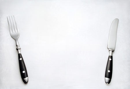 Fork and knife on white cloth