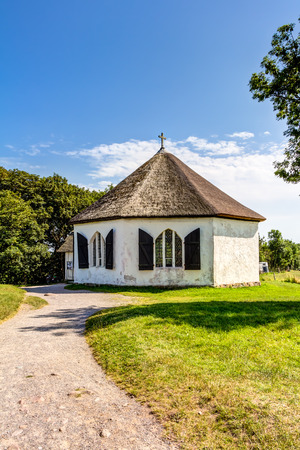 Chapel in Vitt with traditional thatching roof house on Rugia