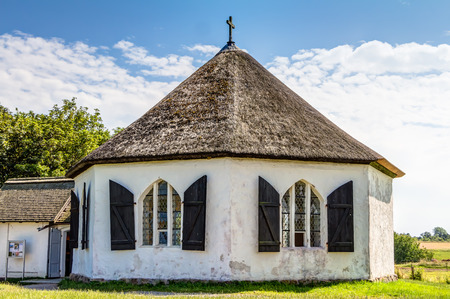 heritage protection: Chapel in Vitt with traditional thatching roof house on Rugia