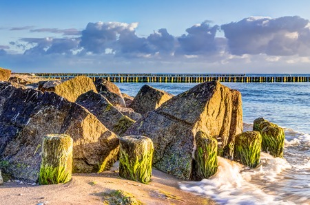 groynes: Wooden and rocky groynes on the coastline of the Baltic Sea, Germany