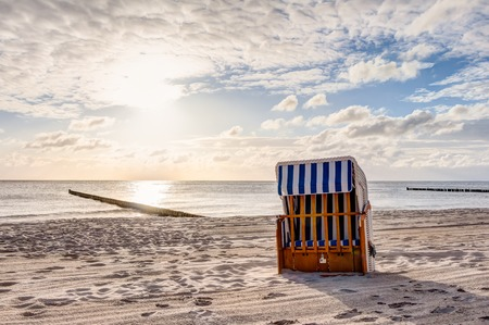 Beach chairs in the morning after sunrise in summer