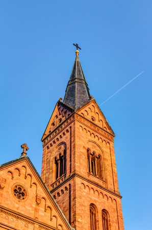 Einhard basilica against blue sky at sunset in Seligenstadt